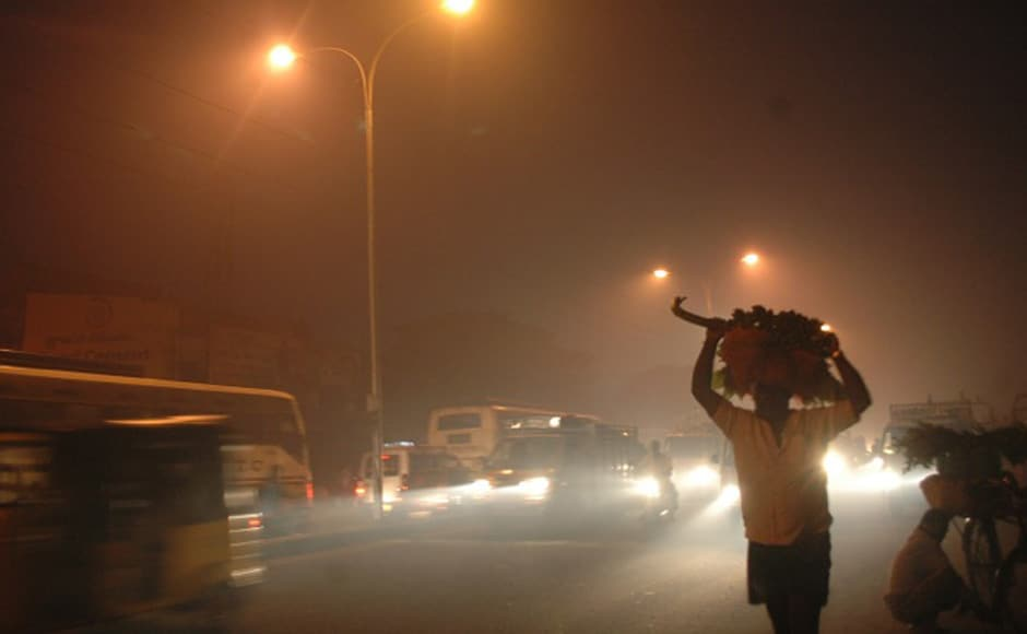 "The city shrouded in smoke from burning discarded materials on ""bhogi"" night. Firstpost"