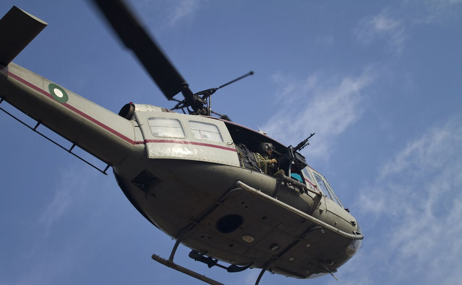 An army helicopter monitors the protest march. AP