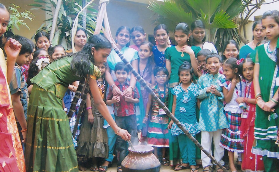 Kids cooking the pongal dish - rice with milk and jaggery. Firstpost