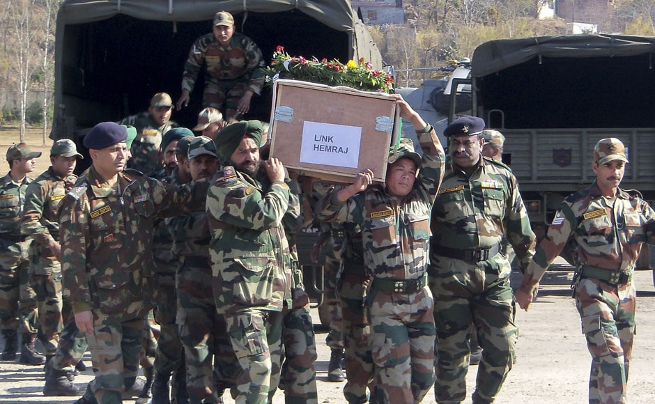 Indian army soldiers carry a coffin containing the body of one of the soldiers who was killed by Pakistani soldiers. AP