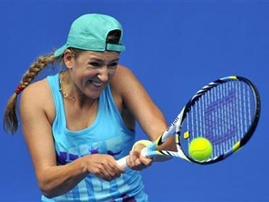 Azarenka of Belarus hits a return during a practice session at the Australian Open tennis tournament in Melbourne. Reuters