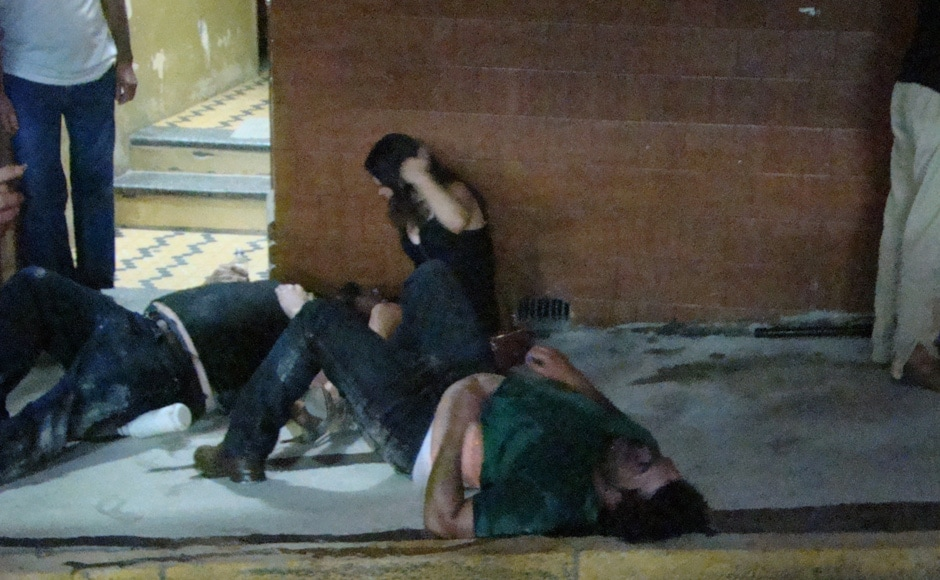 Injured people lies on the ground outside the Kiss nightclub in Santa Maria city, Rio Grande do Sul state, Brazil, Sunday, Jan 27, 2013. AP