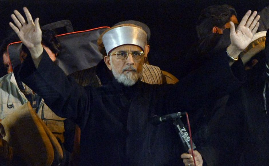 Qadri gestures upon his arrival at the protest march. AFP