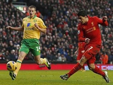 Liverpool's Suarez shoots past Norwich City's Bennett to score his sides second goal during their Premier League match at Anfield in Liverpool. Reuters