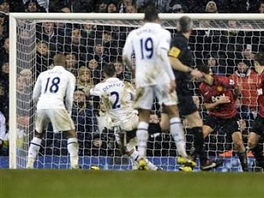 Tottenham Hotspur's Dempsey scores against Manchester United during their Premier League soccer match at White Hart Lane in London. Reuters