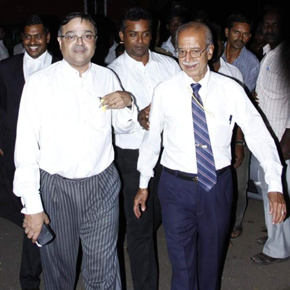 Kamal Haasan's brother Chandra Hasan (on the right in a tie) and his lawyer PS Raman. Firstpost