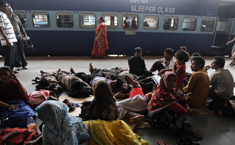 Stranded travellers rest on a platform at the NJP railway station during a strike in Siliguri on 5 July, 2010. An opposition-led strike over fuel price rises disrupted life across the country triggering transport mayhem and sporadic violence in major cities where schools and businesses closed down. AFP