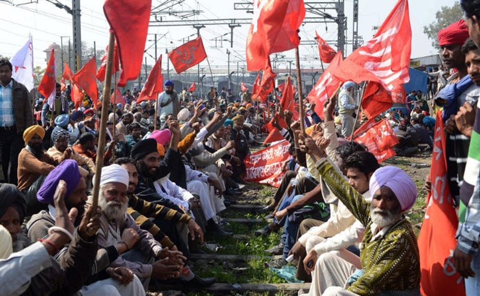 Activists from various trade unions block the tracks during a two-day strike opposing the current UPA government's economic policies at the railway station in<br />Amritsar on 20 February, 2013. Millions of India's workers walked off their jobs in a two-day nationwide strike called by trade unions to protest at the