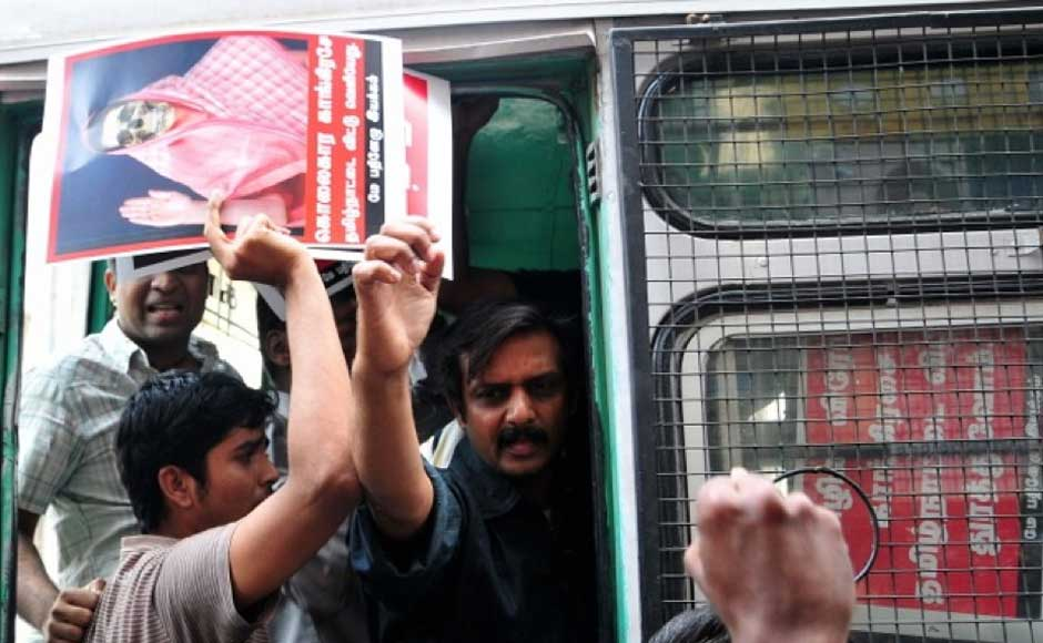 Police detaining protesters who were seeking action against the Congress for its inaction over alleged war crimes in Sri Lanka. Firstpost