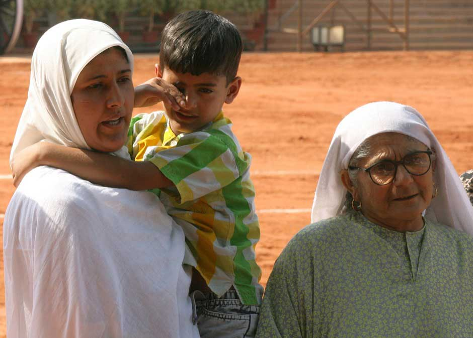 Tabassum (L), wife of Mohammed Afzal Guru, speaks to the media as their son Ghalib and Afzal's mother Ayesha Begum look on after a meeting with the then Indian President A. P. J. Abdul Kalam in New Delhi October 5, 2006. Reuters