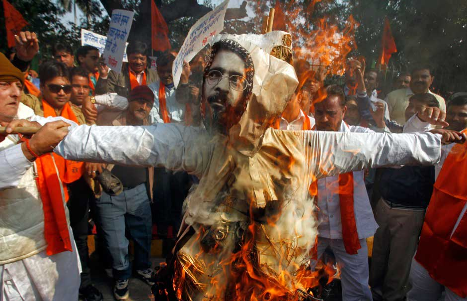 Activists from Hindu right-wing group Shiv Sena burn an effigy depicting Afzal Guru during a protest in New Delhi December 13, 2011. The activists were demanding the execution of Guru, who was convicted and sentenced to death by India's Supreme Court for an attack on the Indian parliament in December 2001. His execution was kept on hold pending a clemency appeal before the then president of India Pratibha Patil. REUTERS