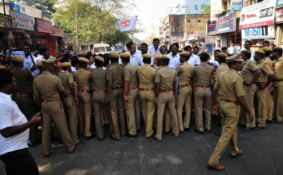 Police try to control the crowd at the protest rally. Firstpost.