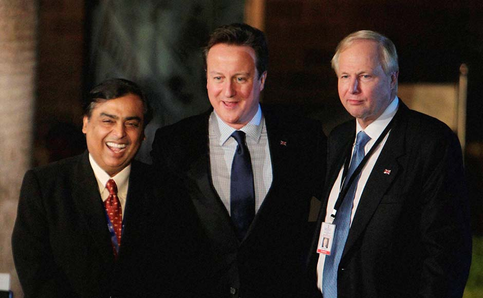 British Prime Minister David Cameron flanked by Mukesh Ambani and Chief Executive, BP, Bob Dudley,  pose for pictures at the Chatrapati Shivaji Museum in Mumbai. PTI