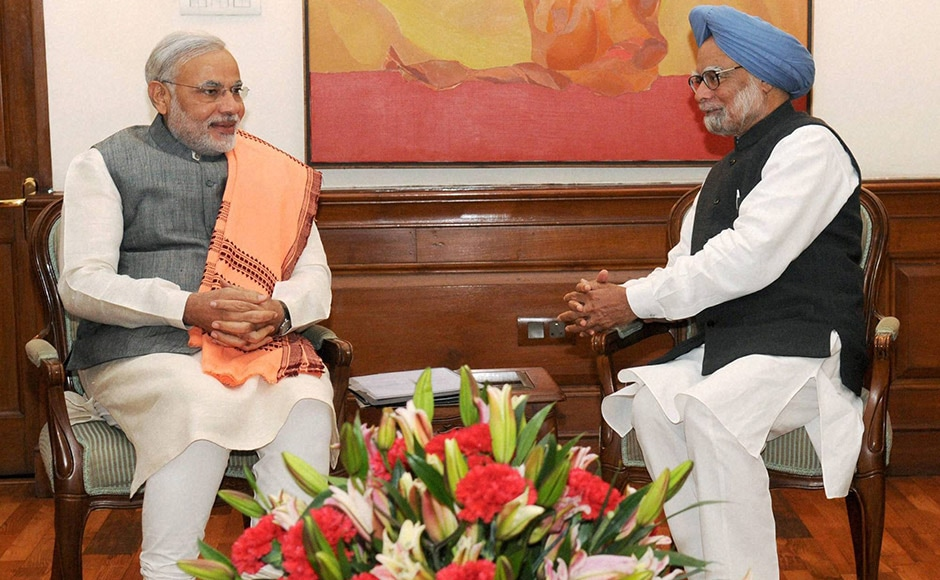 Prime Minister Manmohan Singh with Gujarat Chief Minister Narendra Modi at a meeting in New Delhi. PTI