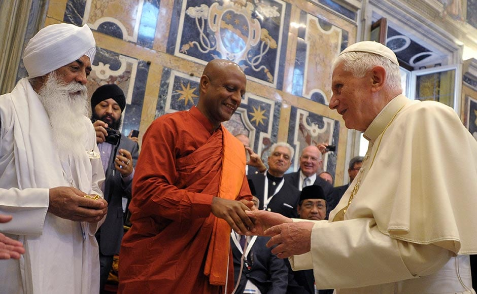In this 28 October, 2011 file photo provided by the Vatican newspaper L'Osservatore Romano, Pope Benedict XVI receives a delegation of religious leaders from all over the world he met at a peace meeting in Assisi. AP