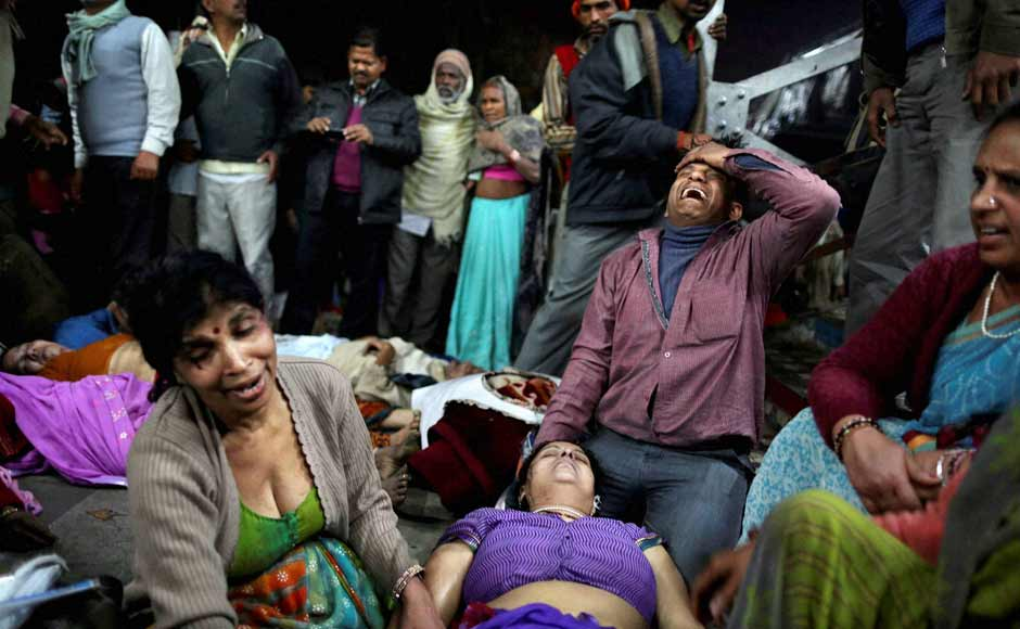 Relatives of a victim mourn at Allahabad station after the stampede. PTI