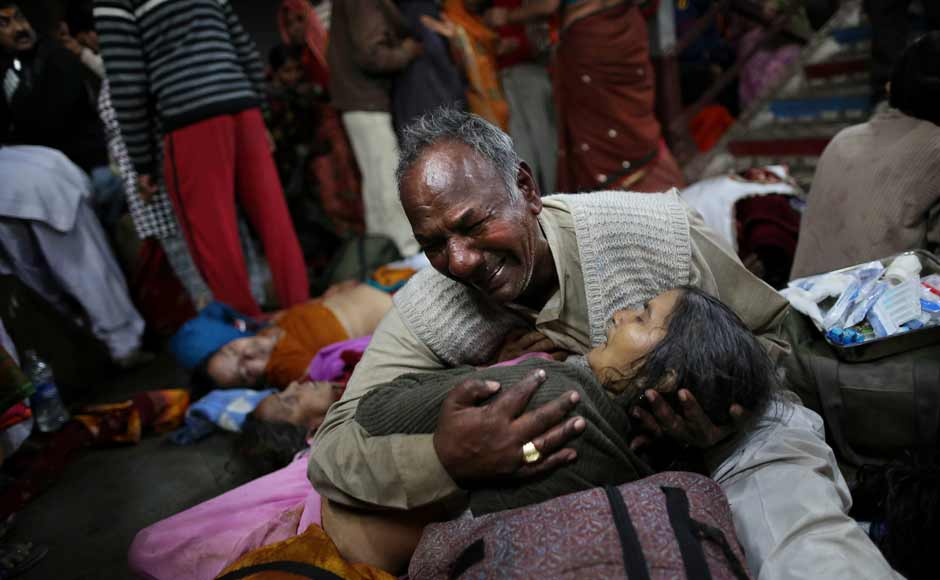 The relative of a victim of the stampede at Allahabad station. Bodies reportedly stayed on the station's platforms for hours. AP