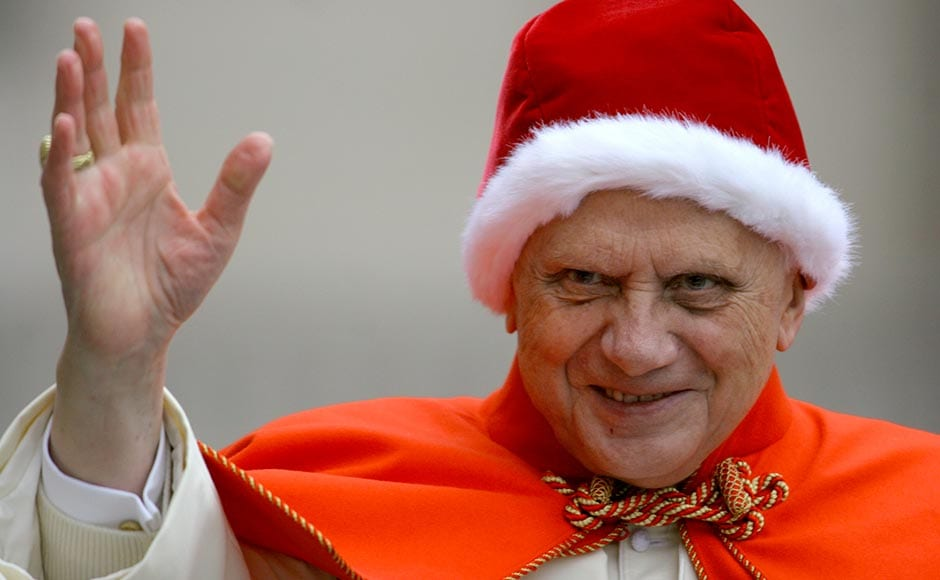 "In this 21 December, 2005 file photo, Pope Benedict XVI, sporting a fur-trimmed hat, waves to pilgrims upon his arrival in St. Peter's Square at the Vatican for his weekly general audience. The red hat with white fur trimming, known in Italian as the ""camauro,"" was popular among pontiffs in the 17th century. Alessandra Tarantino/AP"