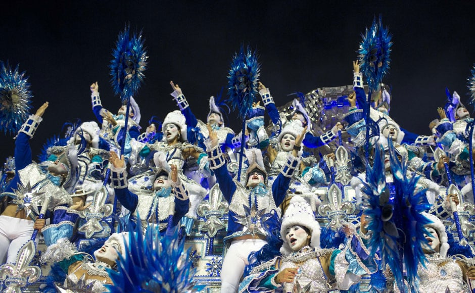 Performers from the Beija Flor samba school parade on a float during carnival celebrations at the Sambadrome in Rio de Janeiro. AP