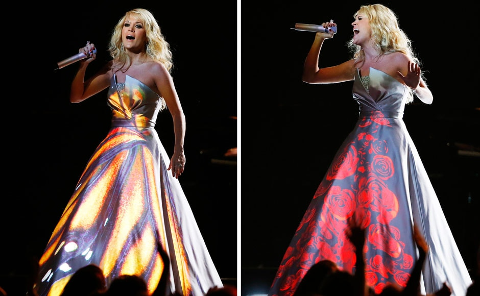Carrie Underwood with different projections on her dress as she peforms at the 55th annual Grammy Awards in Los Angeles. Reuters