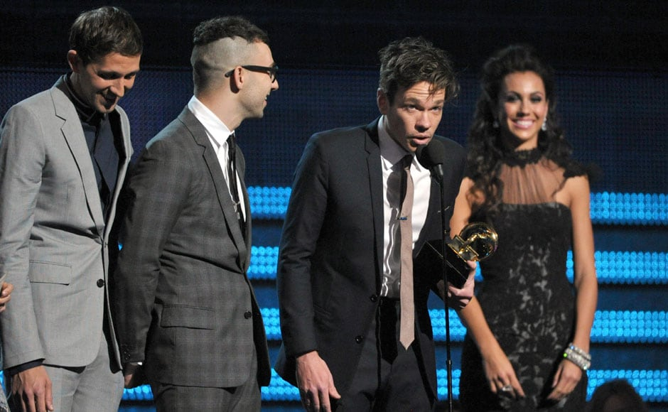 Fun. accept the award for song of the year for We Are Young. AP