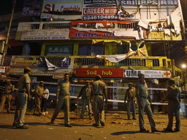 Policemen patrol the scene of the blasts in Hyderabad. AP