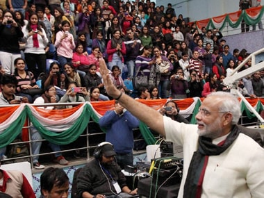 Modi with the audience after speaking at the SRCC. PTI