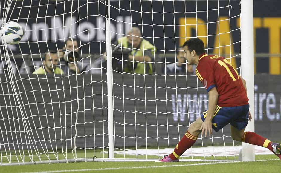 Pedro scores against Uruguay in Spain's 3-1 win over the South American champions. The Barcelona man scored twice for a team made up of nine Barcelona players. Reuters