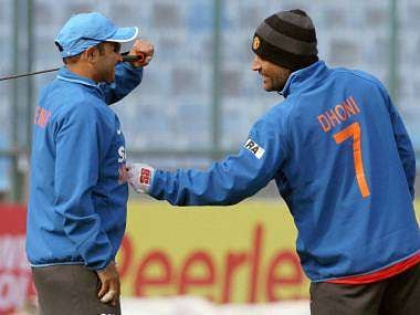 File picture of Sehwag and Dhoni. PTI