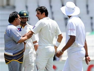 Pakistan team doctor examines Misbah-ul-Haq's elbow after being bowled by Morne Morkel. AP