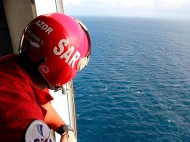 Rescuers during the search for the aircraft: AP