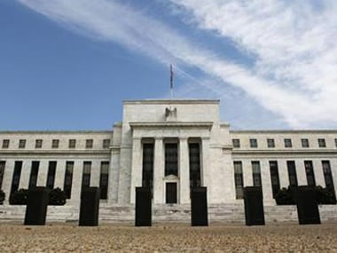 American government (through SEC) for persisting with a regulation which allowed issuers of bonds, i.e. banks and other financial firms, to shop for a rating.