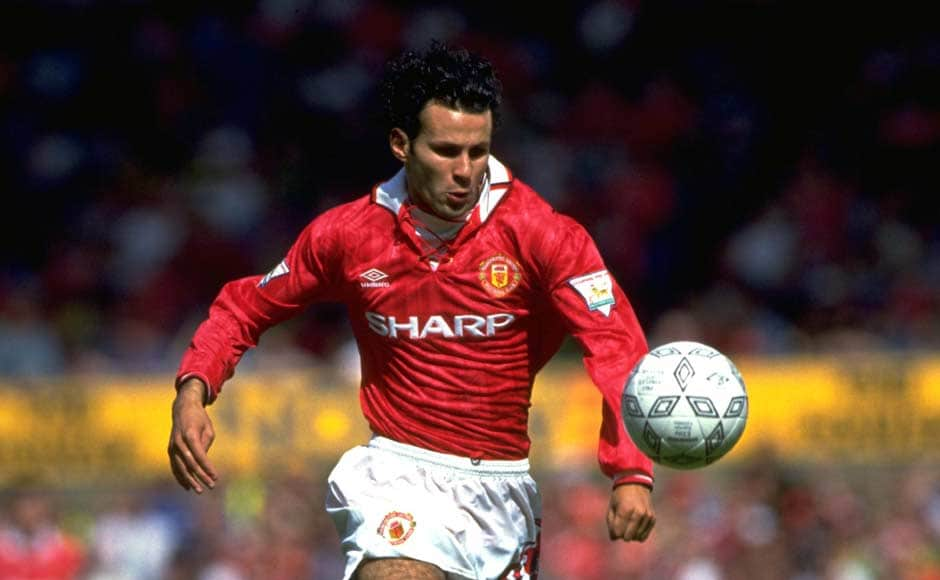 Breaking into the team in 1991, Ryan Giggs was quick to establish himself as a regular. Here he is, curly hair and unlimited energy on the left wing. Getty Images