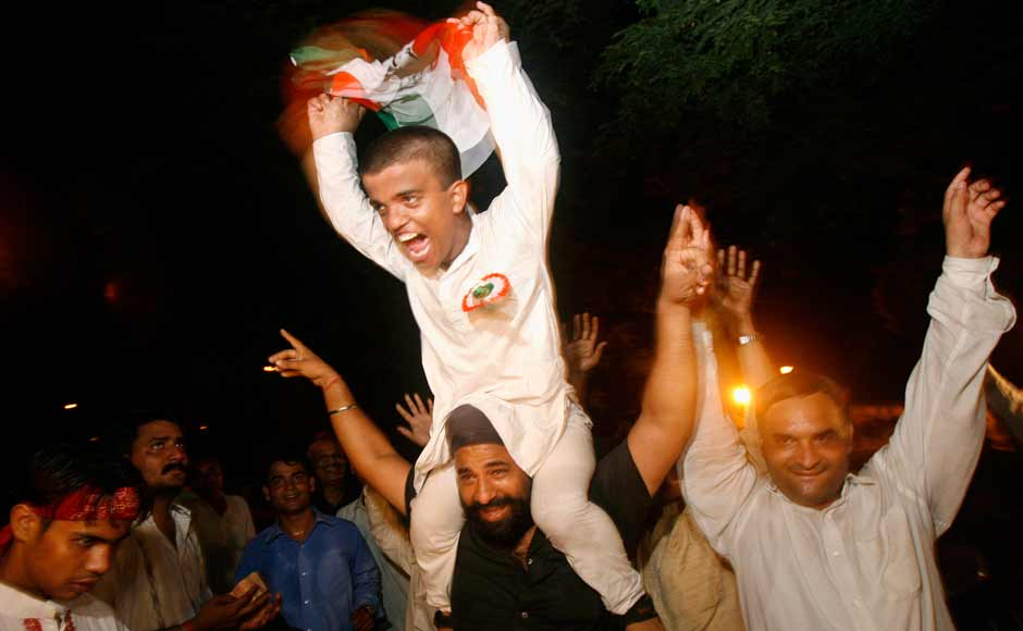 Despite the Left parties withdrawing support to the Congres led government it managed to survive its full term. Supporters of the Congress party celebrate outside the party president Sonia Gandhi's residence on July 22, 2008. Reuters