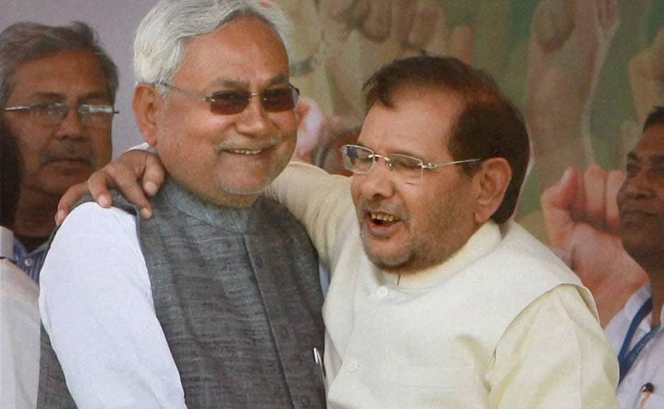 Bihar Chief Minister Nitish Kumar and JD (U) President, Sharad Yadav hug each other at 'Adhikar rally' demanding special status for state at Ramlila Maidan in New Delhi. Atul Yadav/PTI