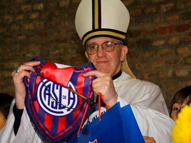 Jorge Bergoglio who is now Pope Francis, poses with a jersey from the San Lorenzo soccer club, of which he is known to be a fan: Reuters File photo
