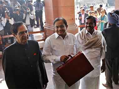India's Finance Minister Palaniappan Chidambaram (C) arrives at the parliament to present the 2013/14 federal budget in New Delhi February 28, 2013. Reuters
