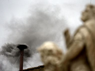 Black smoke billows from a chimney atop the Sistine Chapel in Vatican. AP