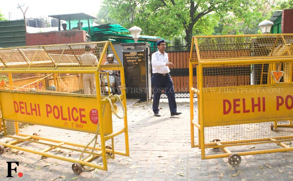 Security tightened outside the residence of Union Home Minister Sushilkumar Shinde with the deployment of armed police personnel. Naresh Sharma/ Firstpost