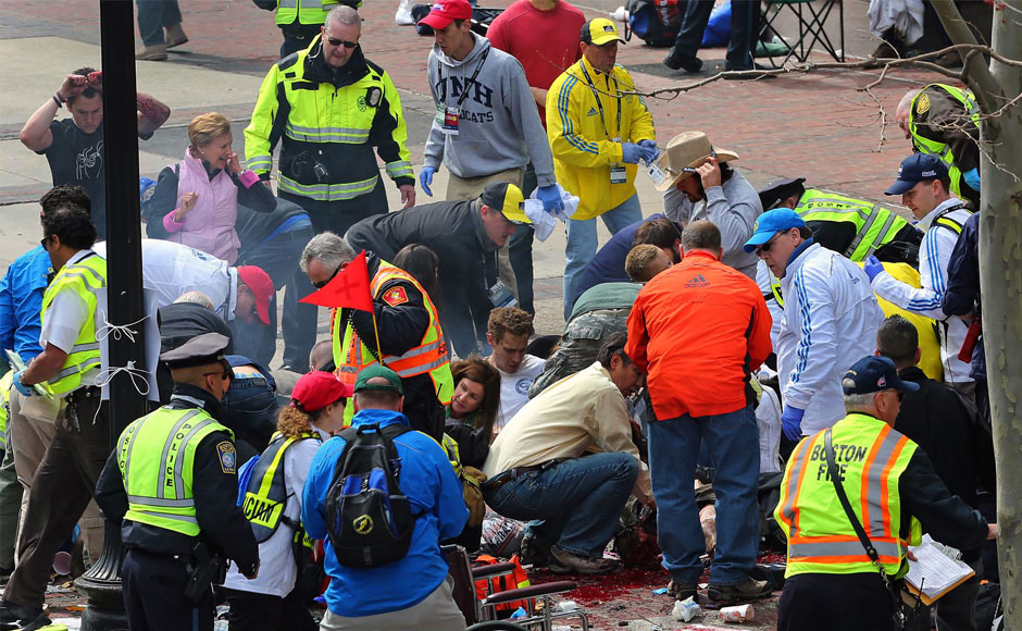 Medical workers aid injured people at the 2013 Boston Marathon following an explosion in Boston, Monday, April 15, 2013.  AP Photo/The Boston Globe, David L Ryan