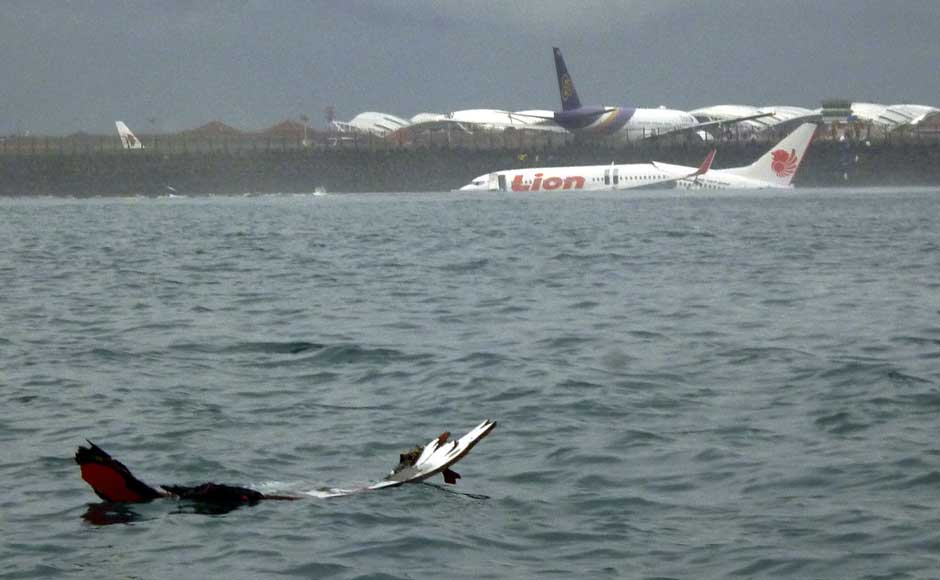 <br />The wreckage a crashed Lion Air plane sits on the water near the airport in Bali, Indonesia on 13 April 2013.