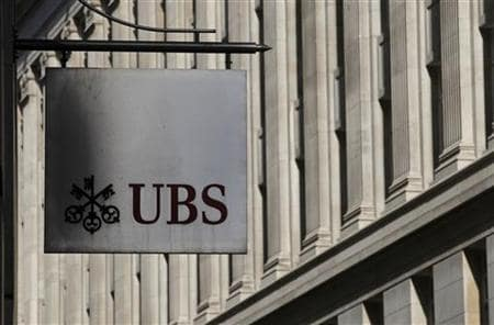 UBS shrugs off break up call, with shareholder support