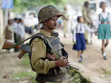 A security personnel keeps guard in Manipur. Reuters