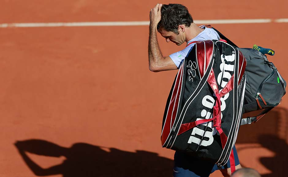 Images: Tsonga ousts Federer in French Open quarters
