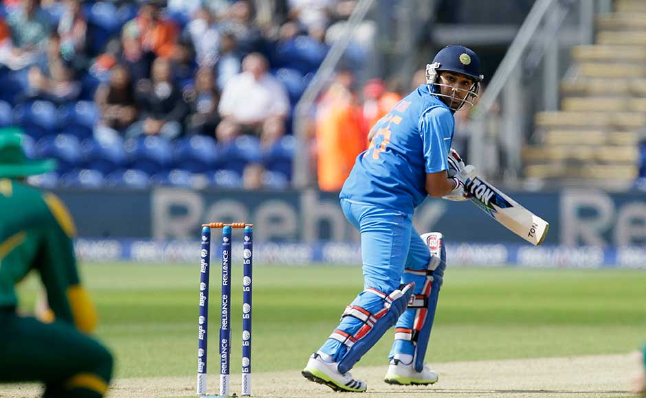 Rohit Sharma edges through the slips during the match against SA. He scored a fine 65. Alastair Grant/Associated Press