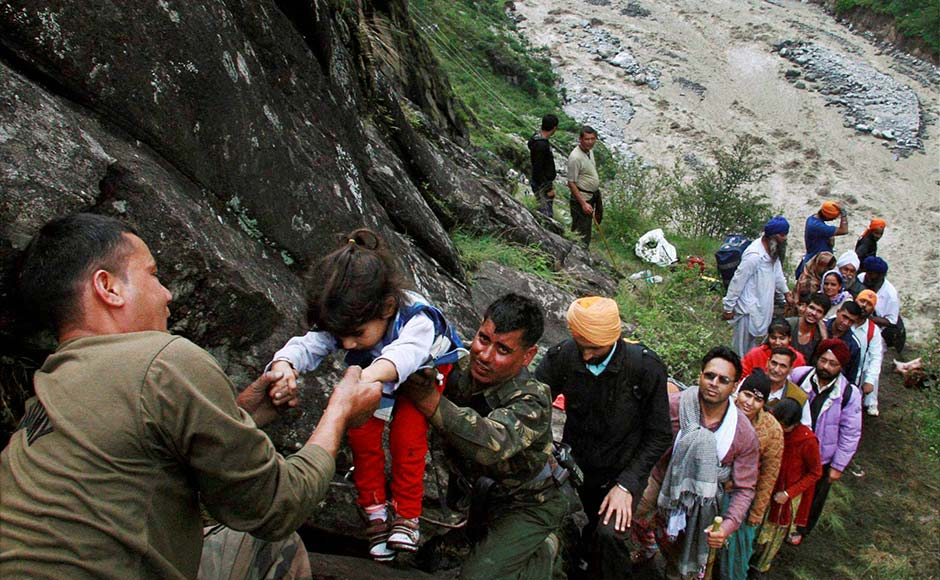 Chamoli: Army personnel rescue stranded children and other pilgrims to a safe place in flood-hit Govind Ghat in Chamoli, Uttarakhand. PTI