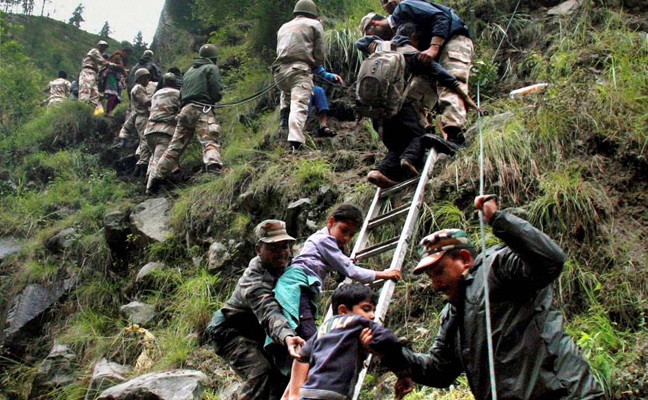 Chamoli: Army personnel rescue stranded pilgrims to a safe place in flood-hit Govind Ghat in Chamoli, Uttarakhand. PTI