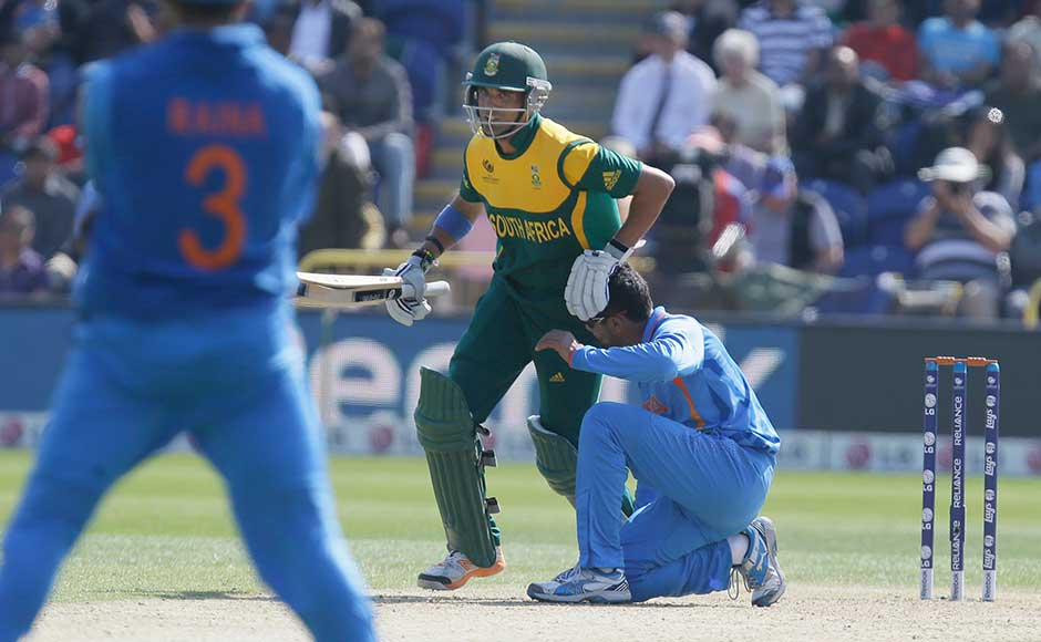 Ravindra Jadeja falls to the ground as South Africa's Robin Peterson pushes past for a single run during their group stage ICC Champions Trophy cricket match in Cardiff, Wales. Alastair Grant/ Associated Press