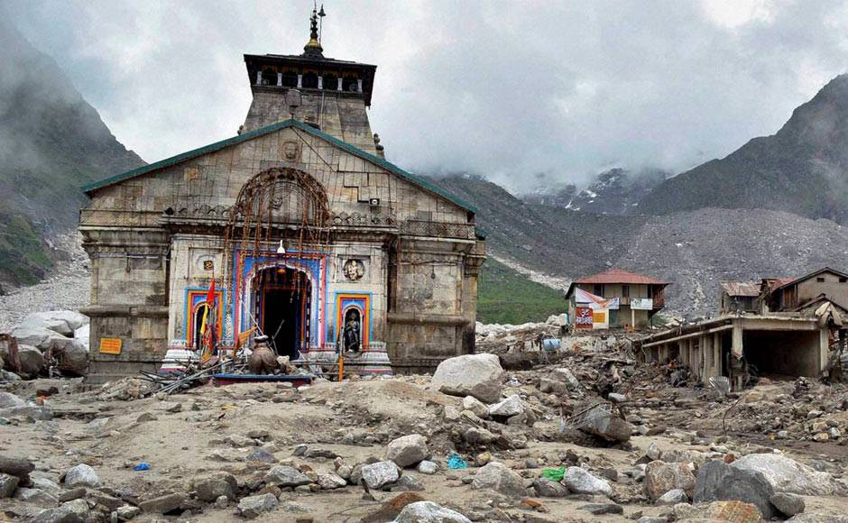 Kedarnath shrine, one of the holiest of Hindu temples dedicated to Lord Shiva, and other buildings around are in a damaged state after heavy rains in Uttarakhand. PTI