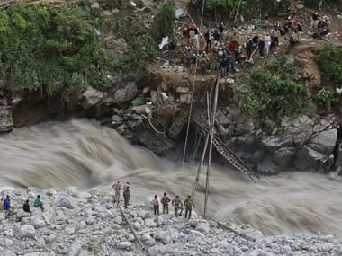 Army engineers looking to restore a fallen bridge over the Ganga in spate. Reuters